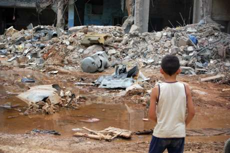 Boy looking at rubble