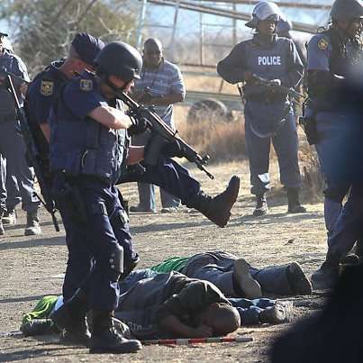 the_lonmin_massacre_putting_the_capitalist_boot_in.jpg