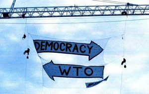 Democracy one way, WTO other way - famous banner drop Seattle '99