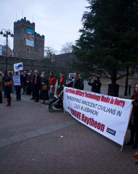 "Banner at the Rally in Derry against Israel's attacks on Gaza:  ""Raytheon Military technology Made in Derry, MURDERING INNOCENT CIVILIANS  IN GAZA & LEBANON.  REMOVE Raytheon"""