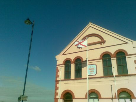St Patrick's flag flutters in front of Limavady Orange Hall, Co Derry