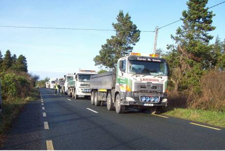 Trucks blocked up behind lock-on on haulage route