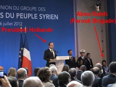 6th July 2012, War criminal Abou Saleh (Brigade Farouk) was special guest of President François Hollande (young man facing the camera). He had directed the Islamic Emirate of Baba Amr and ordered more than 150 people to have their throats cut in public
