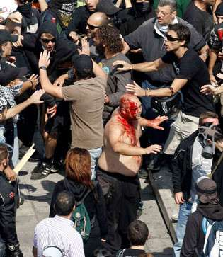 fascist, perhaps cop, attacked by leftists in Athens