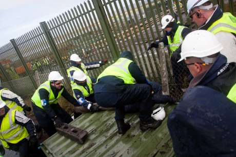 people being forcably removed from fence panels