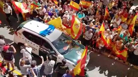 "crowds screamed ""let them fucking have it!"" as the paramilitary Guardia Civil vans left for Catalonia this week."